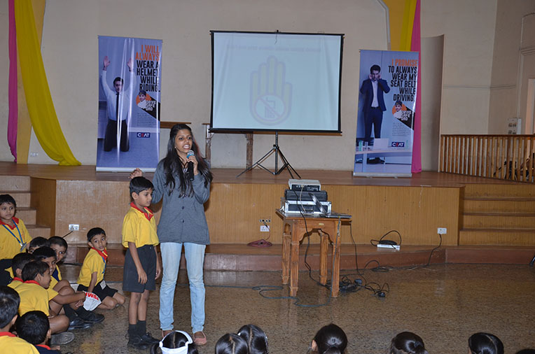 Kids from St. Alyosius High School interacting with CEAT team during the 'Drive Safe Dad' campaign in their auditorium