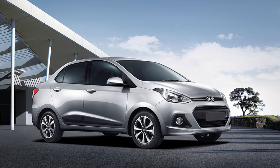 Top 6 compact sedan cars to buy in 2016 gaadikey for Hyundai xcent exterior