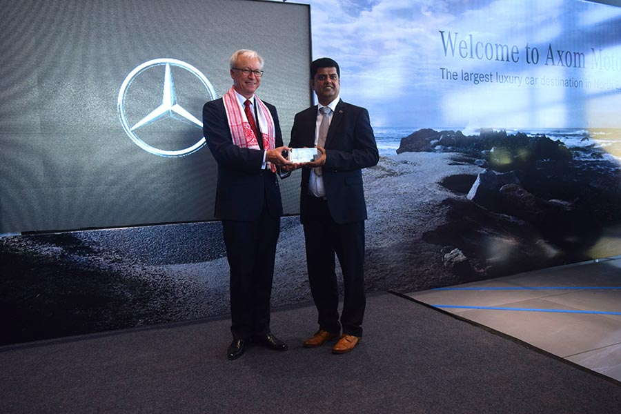 mr-roland-folgermd-ceomercedes-benz-india-presenting-a-memento-to-mr-sanjive-narainmanaging-partneraxom-motors-at-the-inauguration-of-the-new-dealership-in-guwahati