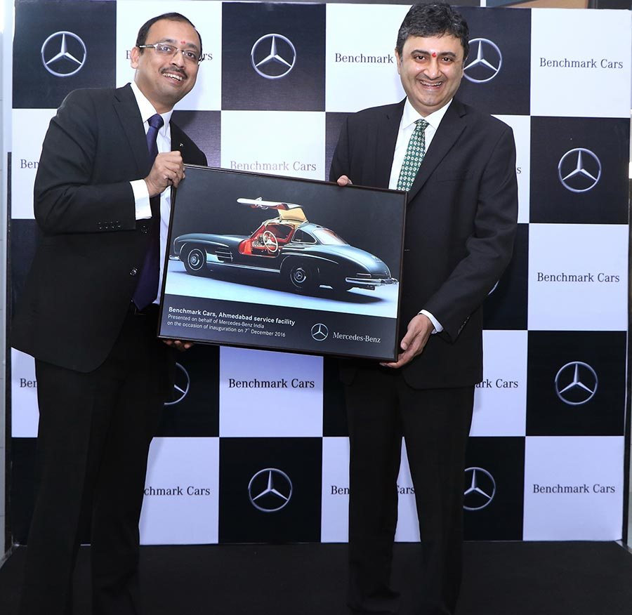 mr-santosh-iyer-vp-after-sales-and-retail-training-mercedes-benz-india-presenting-a-memento-to-mr-sanjay-thakker-chairman-benchmark-cars-at-ahmedabad-workshop