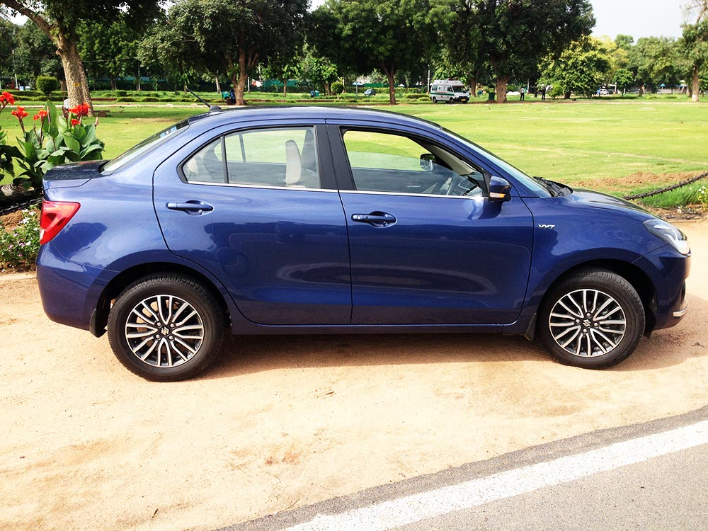 Maruti Dzire Blue Color Oxford Blue On Grass Background